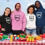 mockup-of-a-group-of-friends-with-hoodies-at-a-tailgate-party-29905 (1)
